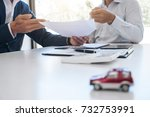 Small photo of Agent man presentation and consulting car insurance detail to customer and waiting for his reply to finish.