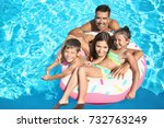 happy family with inflatable... | Shutterstock . vector #732763249