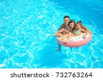 happy family with inflatable... | Shutterstock . vector #732763264