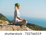 yoga woman sitting on the top...   Shutterstock . vector #732766519