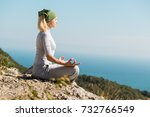 yoga woman sitting on the top... | Shutterstock . vector #732766549