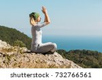 yoga woman sitting on the top... | Shutterstock . vector #732766561