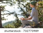 woman meditating in mountains...   Shutterstock . vector #732773989