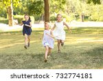 cute girls in park on sunny day | Shutterstock . vector #732774181