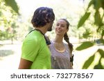 smiling couple stretching... | Shutterstock . vector #732778567
