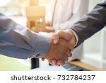 business man shaking hands... | Shutterstock . vector #732784237