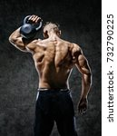 Small photo of Muscular back of man. Rear view of fitness model with kettlebell on dark background. Strength and motivation