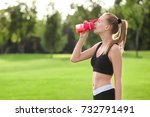 sporty young woman drinking... | Shutterstock . vector #732791491