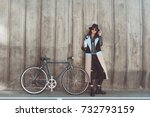 stylish woman in autumn outfit... | Shutterstock . vector #732793159