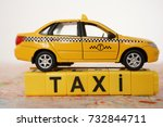 word taxi made of yellow cube... | Shutterstock . vector #732844711