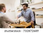 friends playing chess at home | Shutterstock . vector #732872689