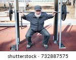 an old man lifting weights in... | Shutterstock . vector #732887575