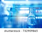 blue glass flask with vial in... | Shutterstock . vector #732909865