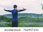 runner on the peak man in his... | Shutterstock . vector #732957151