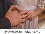 Small photo of acting propose to bride on the wedding, golden rings