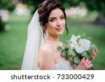 brunette bride poses with white ... | Shutterstock . vector #733000429