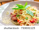 spaghetti in olive oil with... | Shutterstock . vector #733031125
