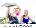 happy family outside | Shutterstock . vector #733040461