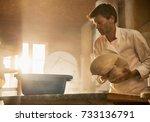 in an artisan bakery  a baker...   Shutterstock . vector #733136791