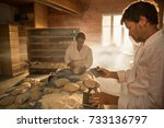 in an artisan bakery  a baker... | Shutterstock . vector #733136797