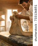 in an artisan bakery  the baker ... | Shutterstock . vector #733136851
