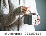 Female Hands Holding Gift Box....