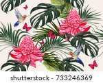 Stock vector beautiful seamless vector floral summer pattern background with hummingbird palm leaves 733246369