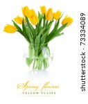 Yellow Tulip Flowers In Glass...