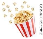popcorn blast on white isolated  | Shutterstock . vector #733354531