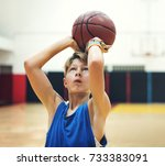 young basketball player shoot | Shutterstock . vector #733383091