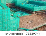 Construction site covered with green net in Guangzhou, China - stock photo