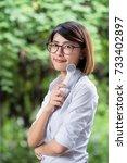 beautiful woman holding a... | Shutterstock . vector #733402897
