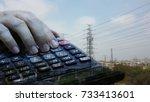 hand using a calculator on... | Shutterstock . vector #733413601