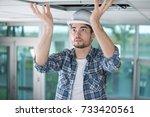 man wiring | Shutterstock . vector #733420561
