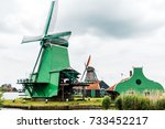 windmills in the netherlands... | Shutterstock . vector #733452217