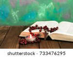 bible crucifix and beads with a ... | Shutterstock . vector #733476295