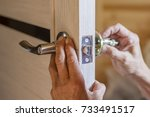 man repairing the doorknob.... | Shutterstock . vector #733491517