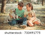 Small photo of Retriever pup Lovely scene young teen sister brother enjoy posing summer time vacation with best friend dog ivory white labrador puppy.Happy airily careless childhood family life world dreams puppies