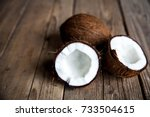 ripe half cut coconut on a... | Shutterstock . vector #733504615