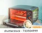 electric micro oven with bread... | Shutterstock . vector #733504999