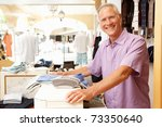 male sales assistant at... | Shutterstock . vector #73350640