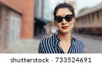 portrait of young woman wearing ... | Shutterstock . vector #733524691