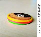 Small photo of Carom Board Colorful Coin