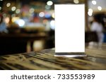 mock up menu frame standing on... | Shutterstock . vector #733553989