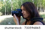 girl with camera with long lens.... | Shutterstock . vector #733596865