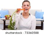 Healthy Young Woman Eating A...