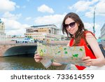 travel tourist woman with map...   Shutterstock . vector #733614559