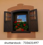 open window with red flower | Shutterstock . vector #733631497