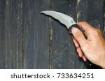 A Man Holds A Knife In His...