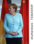 Small photo of JULY 5, 2017 - BERLIN: German Chancellor Angela Merkel with her characteristic hand gesture in the Chanclery in Berlin.